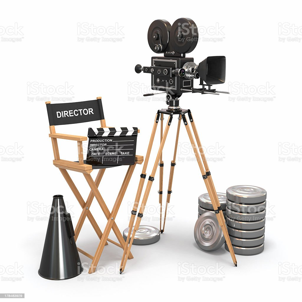 Movie composition. Vintage camera, director chair and reels. stock photo