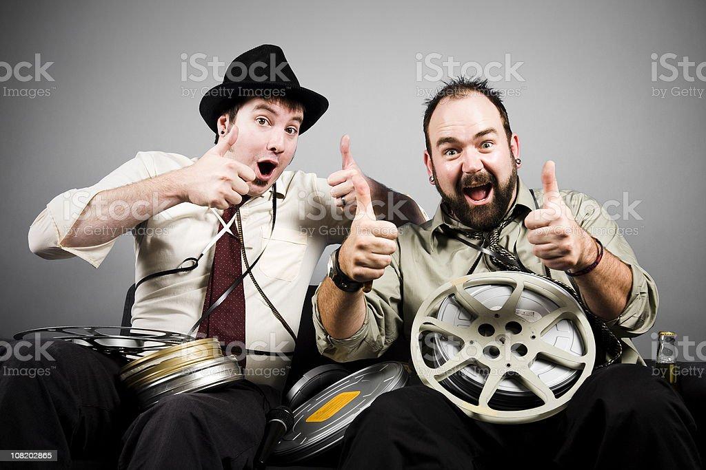 Movie Critics: Two Thumbs Up stock photo