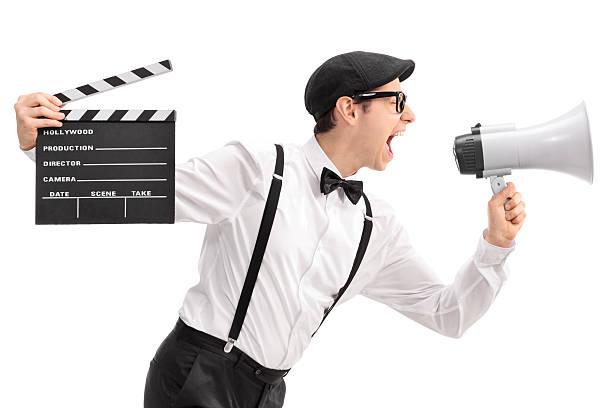 film director hält ein erste klappe fällt und schreien auf megafon - klappe hut stock-fotos und bilder
