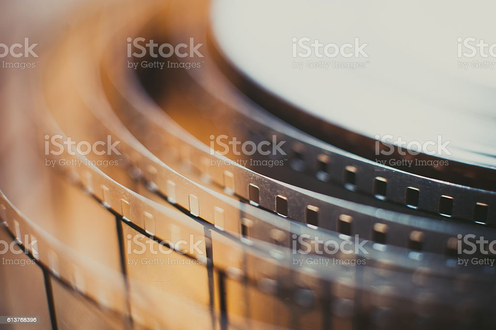 Movie film reel detail, unrolled film close up stock photo