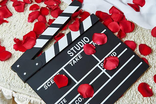 film emanzipierte frau mit rosenblättern - wedding photography and videography stock-fotos und bilder