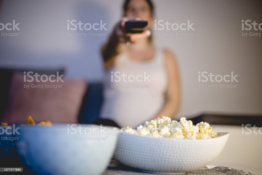 Movie night at home with some snacks stock photo