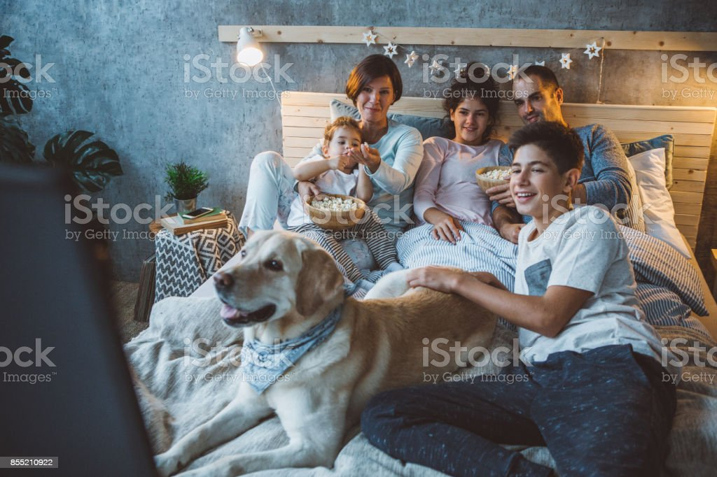 Movie night is their favourite family tradition stock photo