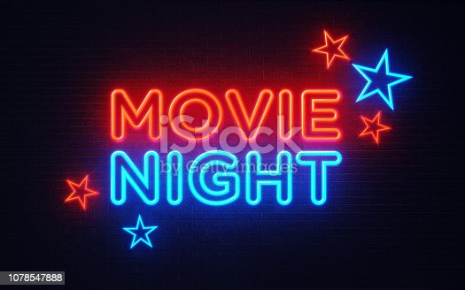 991292404 istock photo Movie Night Neon Light On Black Wall - Movie Night Concept 1078547888