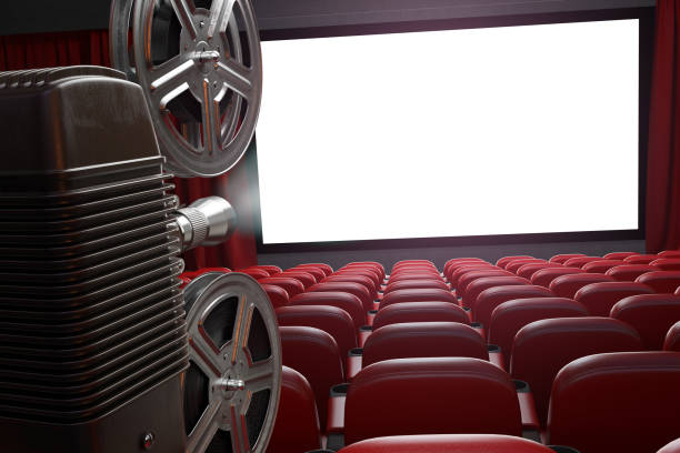 Movie projector and blank cinema screen with empty seats. Cinema, movie or home video concept background. stock photo