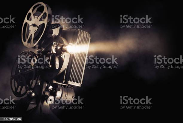 Movie projector on dark background picture id1007557230?b=1&k=6&m=1007557230&s=612x612&h=jmioviwduldrrnum8lzho62sauakitzaqkyjhnobnvs=
