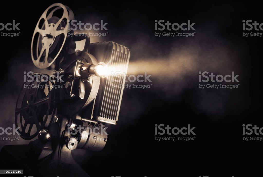 Movie projector on dark background stock photo