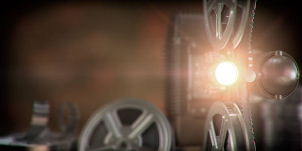 Movie projector with light beam and film reels on dark background. Cinema, movie, video retro vintage background. stock photo