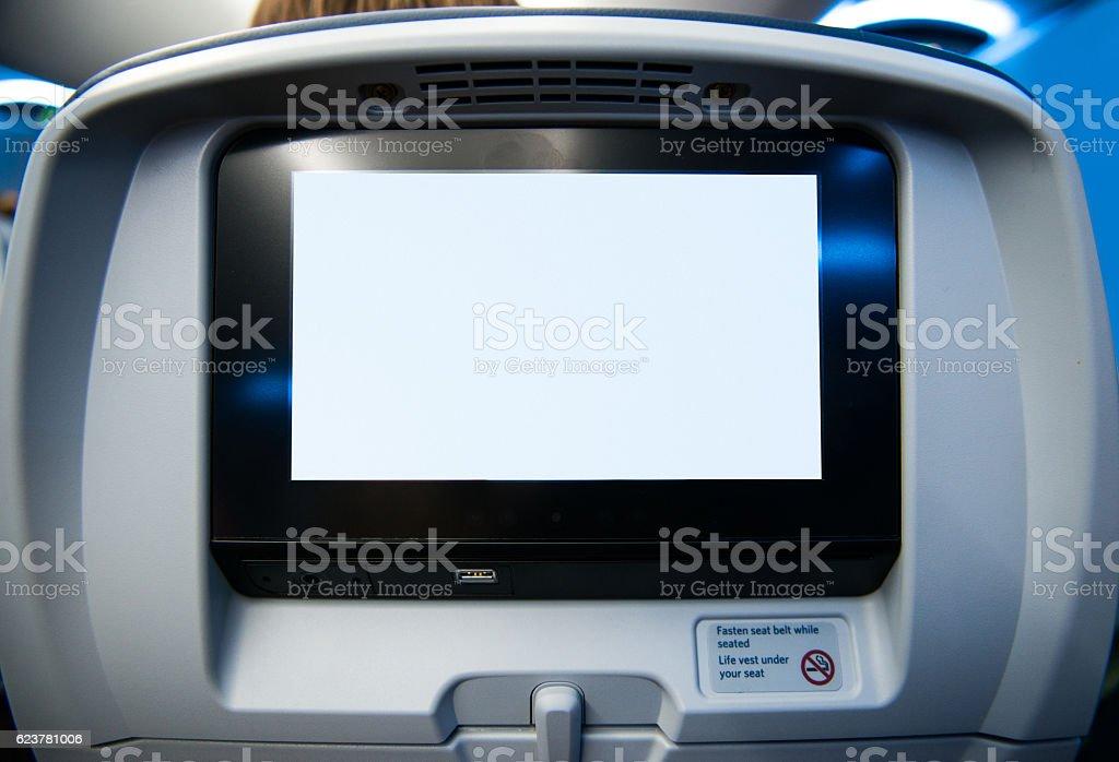 Movie Screen on Passenger Seat of Airplane stock photo