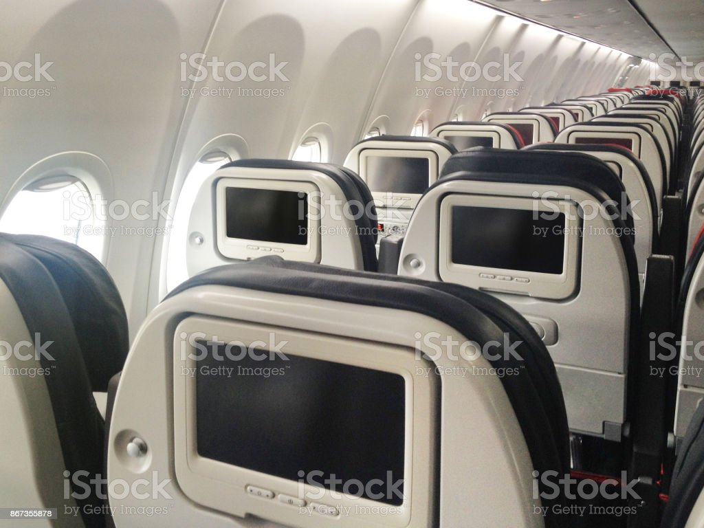 Movie Screen on Passenger Seat of Airplane stock photo