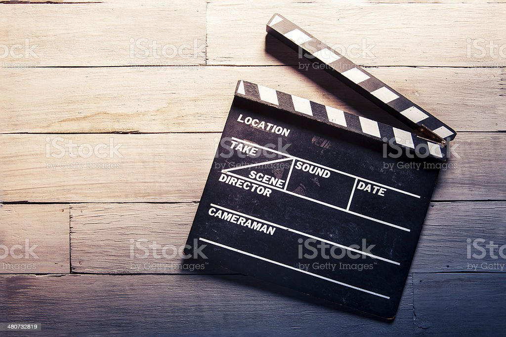 movie slate on a wooden background stock photo
