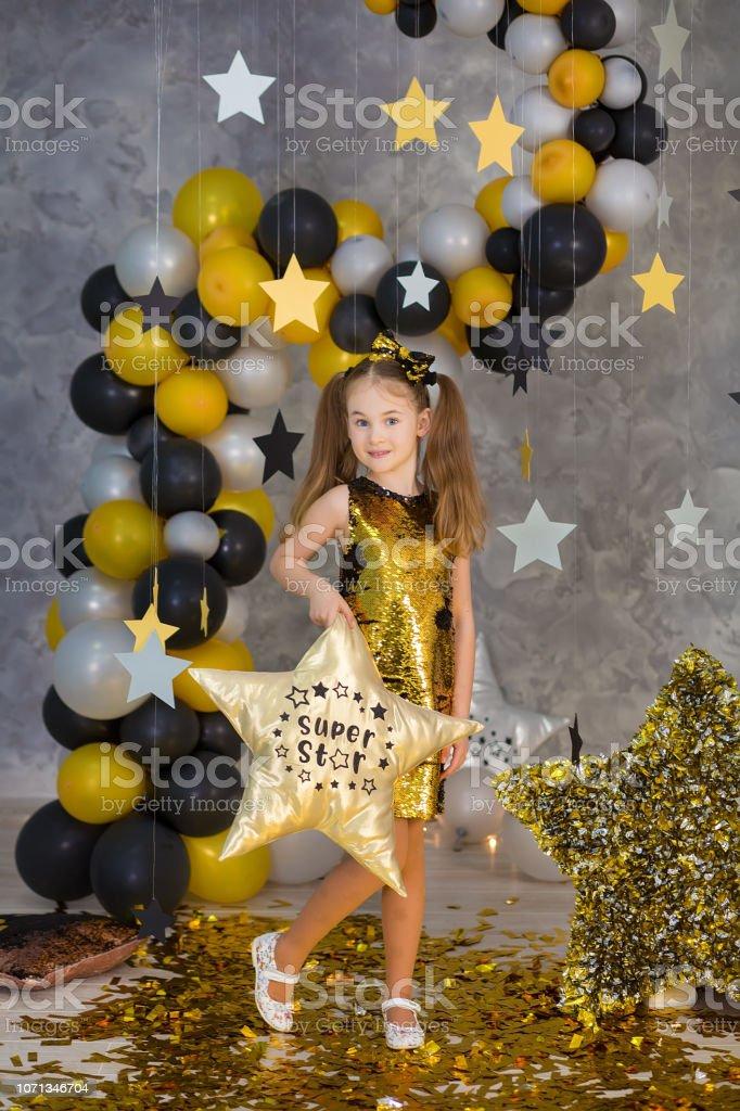 Movie super star girl model posing in studio shoot with golden star...