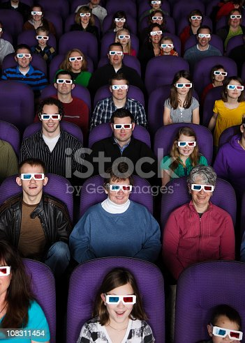 A group of audience members watching a 3D movie in a dark movie theater.  [url=search/lightbox/2239437] [img]http://richlegg.com/istock/banners/movies_banner.jpg[/img][/url] [b][url=search/lightbox/2239437]Click here to see more At The Movies images[/url][/b]