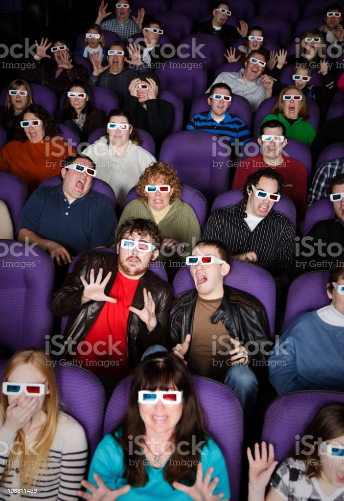 3D Movie Theater Audience royalty-free stock photo