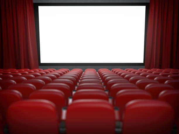Movie theater with cinema blank screen and rows of red seats. stock photo