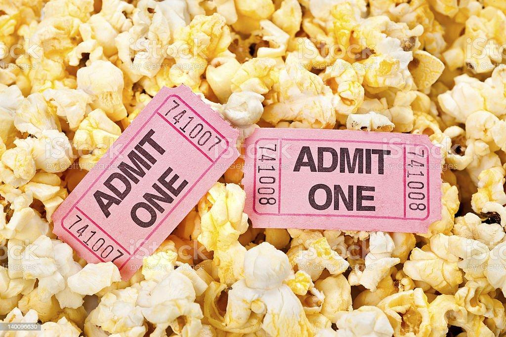 Movie tickets and popcorn stock photo