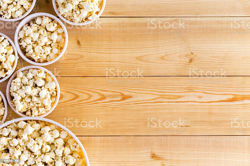 Movies background with popcorn bowls on table stock photo