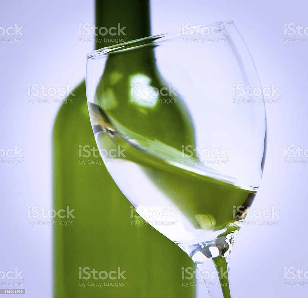 Moving a glass of white wine to be sniffed royalty-free stock photo