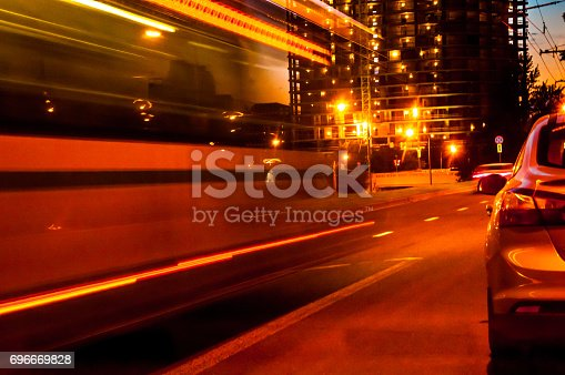 820883024 istock photo A moving blurred bus with yellow and red lights on the asphalt city road 696669828