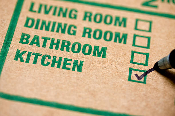 Moving box Moving box with checkmark on kitchen labeling stock pictures, royalty-free photos & images