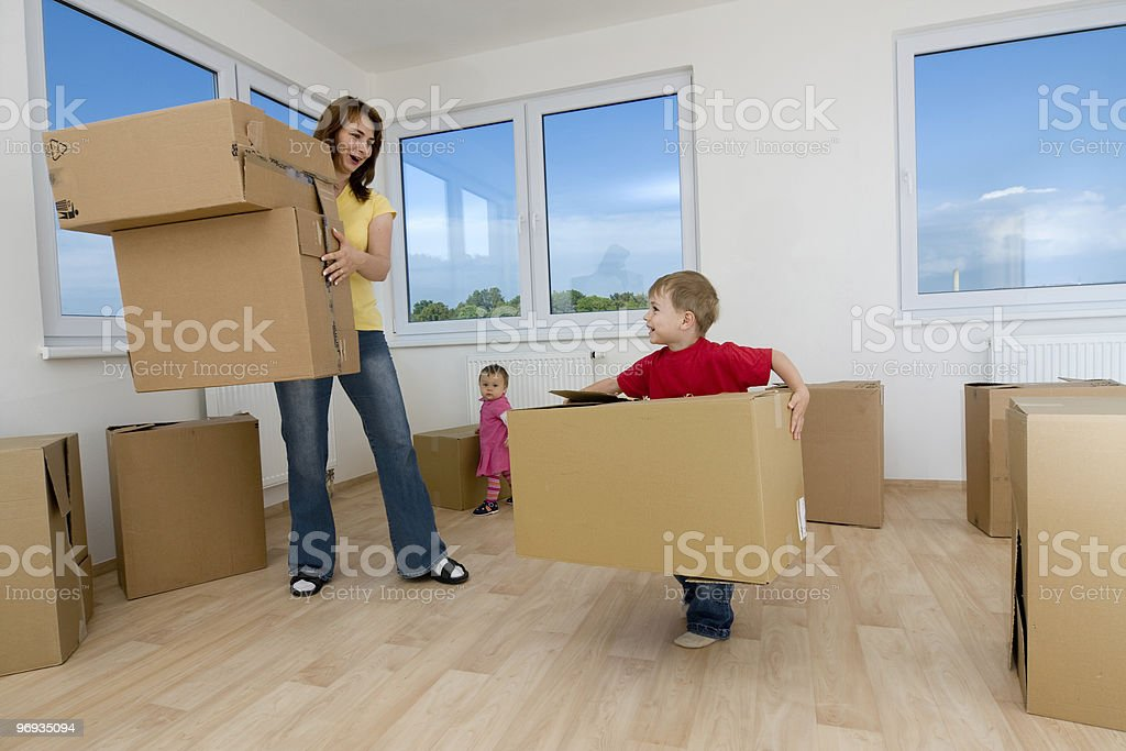 Moving boxes and new home royalty-free stock photo