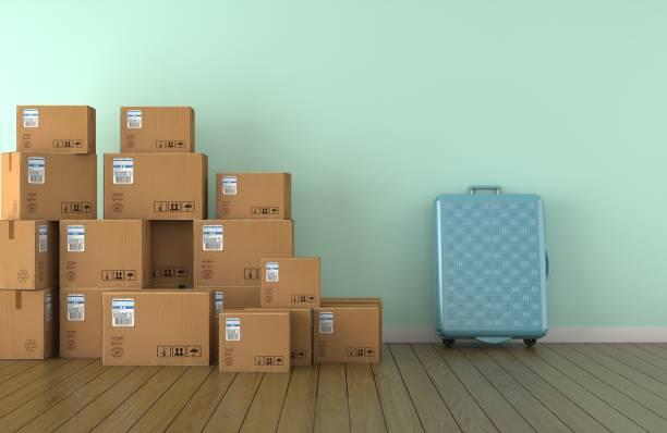 boxen und reisesack in leeren raum vor einer blauen wand verschieben. 3d-rendering - gepäck verpackung stock-fotos und bilder