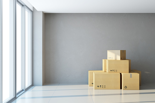 istock moving boxes at a new office 1053834166