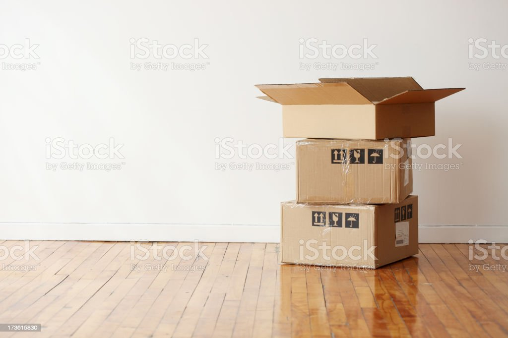 Moving boxes in a large empty room royalty-free stock photo
