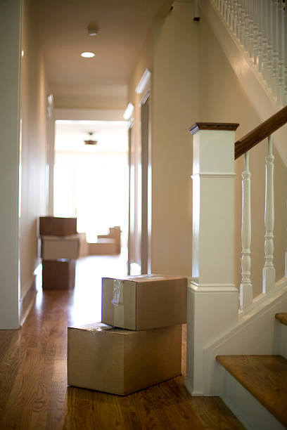 Moving boxes in hallway of new home stock photo