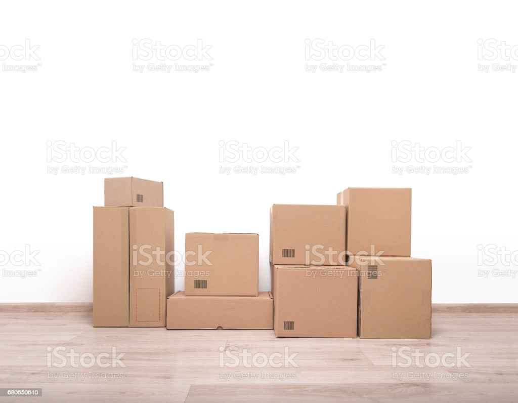 Moving boxes on the floor. stock photo