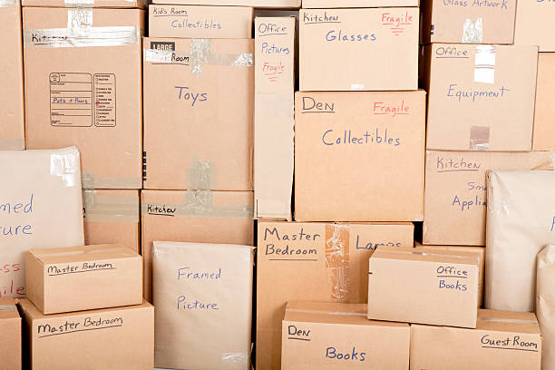 moving boxes - relocation stock photos and pictures