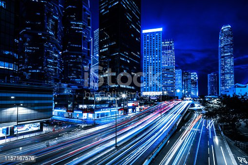 860696690 istock photo Moving car with blur light through city at night 1157167576