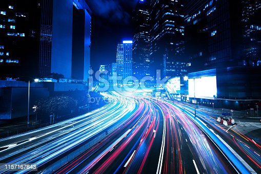 860696690 istock photo Moving car with blur light through city at night 1157167643