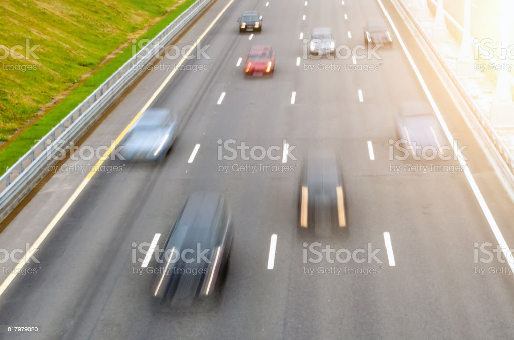 Moving cars on a multi-lane road asphalt let the markingsMoving cars on a multi-lane road asphalt let the markings stock photo