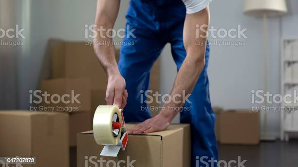 Moving company worker packing cardboard boxes quality delivery picture id1047207878?b=1&k=6&m=1047207878&s=612x612&h=vv8ds7 tyt1 b kka8jydfkqacpzmnu9 hv6 ixnk2c=