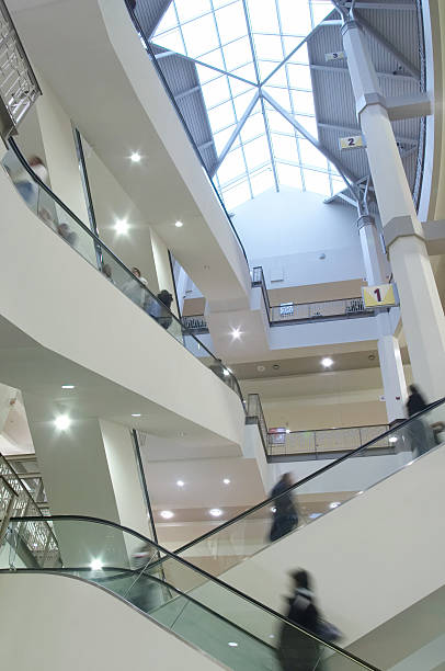 Moving Crowd On Escalator stock photo