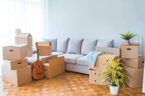 Moving day concept Moving day concept, cardboard carton boxes stack with household belongings in modern house living room, packed containers on floor in new home, relocation, renovation, removals and delivery service physical activity stock pictures, royalty-free photos & images