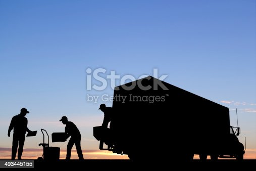A royalty free image from the transportation industry of a truck unloading.