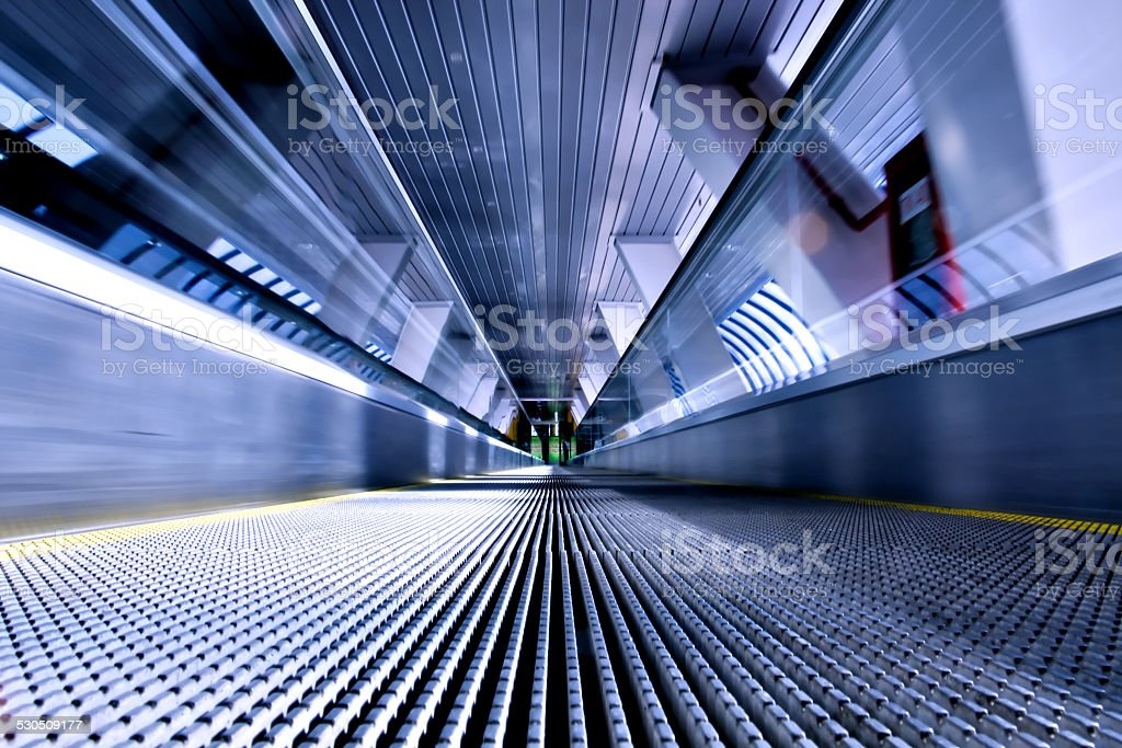 moving escalator in airport stock photo