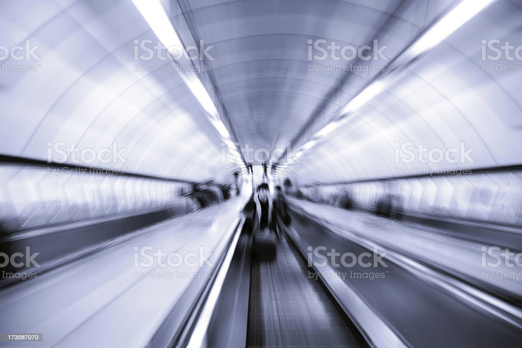 Moving Escalator-Motion Blurred Blue. More in Lightbox below royalty-free stock photo