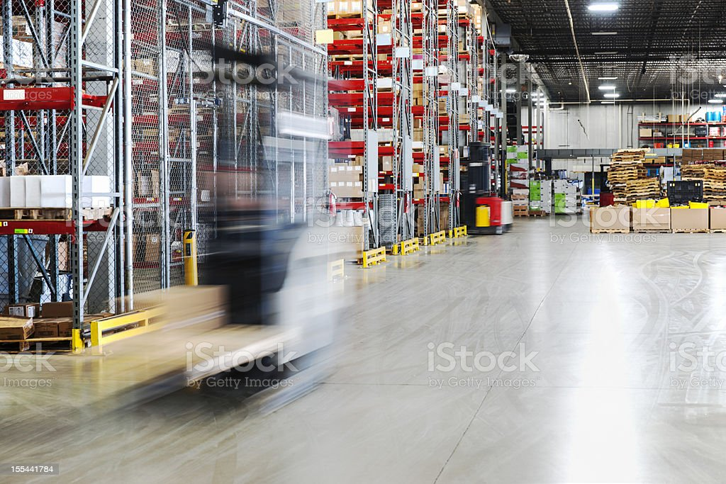 Moving forklift in a warehouse royalty-free stock photo