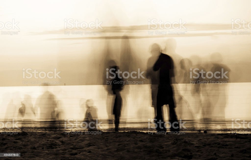 moving ghosts on the beach stock photo