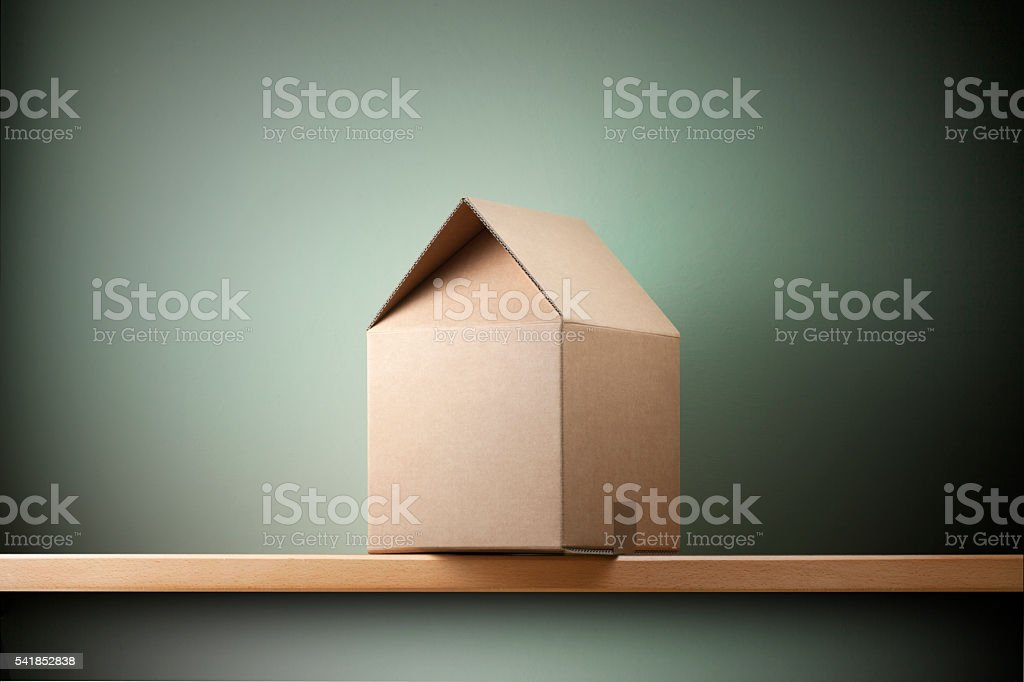 Moving Home Cardboard Box Shaped House stock photo | iStock on cardboard buildings, cardboard houses and shelters, tube house designs, playing card house designs, cardboard house patterns, cardboard structure designs, cardboard barn playhouse, boxcar house designs, cardboard house template, mcpe house designs, paint house designs, simple box house designs, cardboard house ideas, cardboard shelter designs for storage, shoe box house designs, cardboard house plans, prison cell house designs, college house designs, cardboard village houses, cardboard sculpture designs,