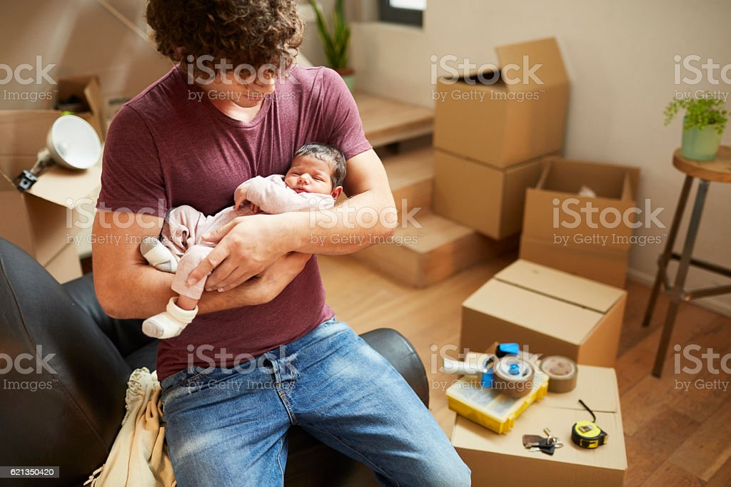 Moving home new beginnings., father and baby. stock photo