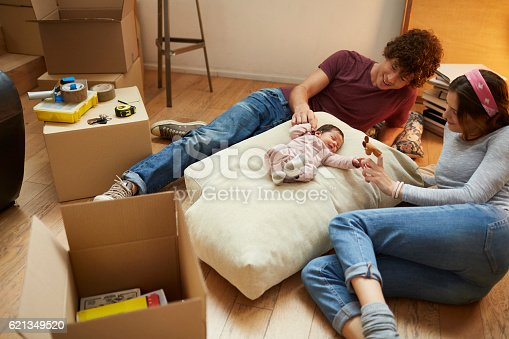 istock Moving home new beginnings. Realaxing with baby. 621349520