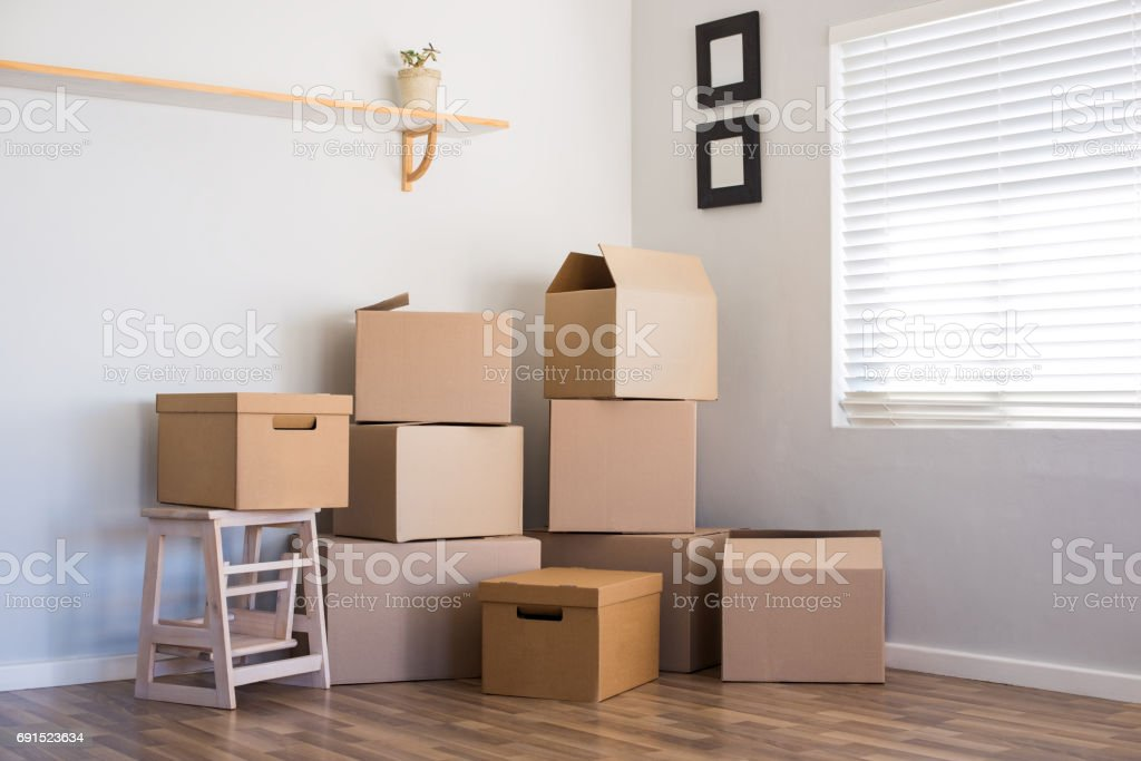 Moving house and boxes stock photo