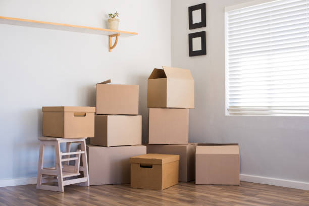 moving house and boxes - physical activity stock photos and pictures