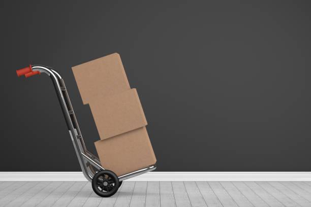 Umzug, Kartons mit Sackkarre – Foto