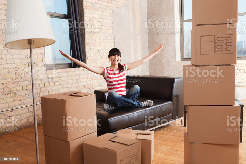 Moving House, Relocating Apartment, Asian Woman with Box Container royalty-free stock photo