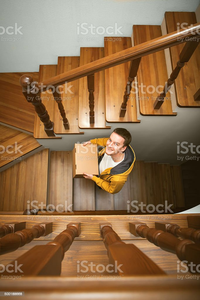 Moving House Young Man With Cardboard Boxes On A Stairs Stock Photo